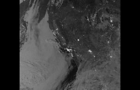 The satellite captured a nighttime view of low-lying marine layer clouds along the California coast on September 27.