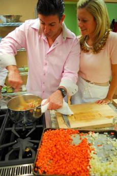 Greg Sullivan stirred risotto while Courtney Palek looked on at Good Life Kitchen couples' cooking class.