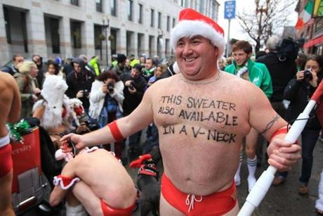 Chuck Mattera took part in the Santa Speedo Run with runners dressed as Santa in red speedos on Boylston Street. Dec. 8, 2012.
