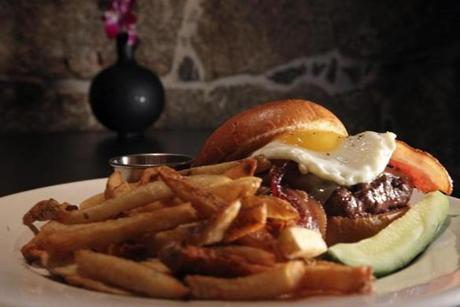 The Granary Burger, topped with bacon and a fried egg.
