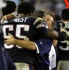 Coach Bill Belichick celebrated with Willie McGinest after time had run out.