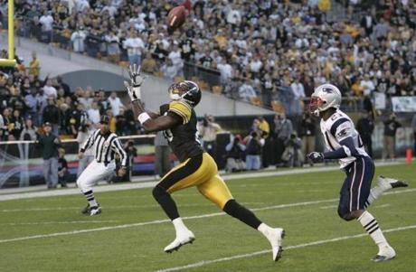 Steelers receiver Plaxico Burress caught a 47 yard touchdown pass in front of Randall Gay.
