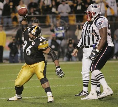 Steelers running back Jerome Bettis spiked the ball in front of Patriots defender Ethan Kelley after a touchdown.
