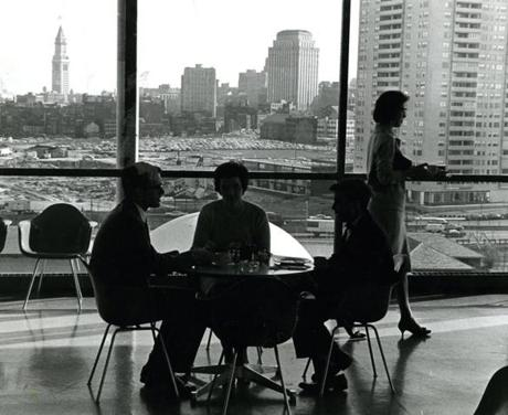 December 11, 1962 : Having lunch at the table and enjoying the view of Boston from the Skylight Room Cafeteria were (l-r) David Harper of Chapel Hill, N.C., and Marie Gilmartin, Wollaston, and Rick Hausman of New York. The Skylight Room sat atop the newly opened Countway Memorial Building, named for the late Boston industrialist Francis A. Countway, a multimillion-dollar seven story structure made possible by a gift from his sister Sandra Countway.