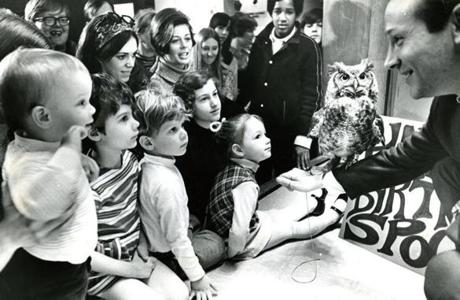 March 26, 1970: Helping to celebrate Spooky the Owl's 19th birthday were (from left) Brian Hurst, 1 1/2, Renee Kellan, 4, Robbie Kellan, 3 and Amy Boyle, 3 all of Andover. Spooky was brought to the Museum in 1951 when he was just born after he was found in Milton minutes after he had apparently fallen from his mother's nest. He demonstrated how owls fly silently, turn their head more than 360 degrees with a stationary body and see in bright daylight as well as darkness. His birthday was celebrated every year until he died at the age of 38.