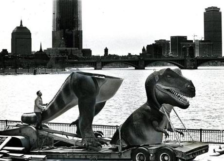April 10, 1972:  It's a good bet that motorists got a start as this truck bore down on them. The huge model of Tyrannosaurus Rex was being transported from the studios of a New York sculptor to its new home at the Museum's newly-constructed West Wing. The effort to join the head of the dinosaur, which has been on display since 1966, to its body was funded by a game called