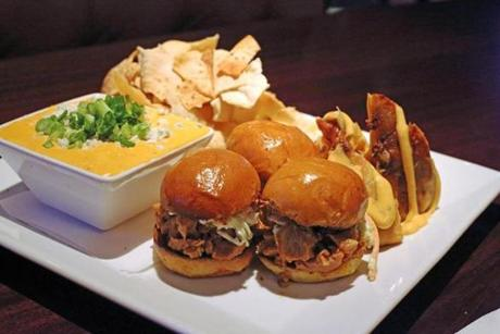 The menu offers hands-on favorites, like the combo platter with buffalo chicken dip, pulled pork sliders, and cheesy spring rolls.