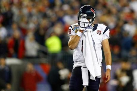 Quarterback Matt Schaub wiped his face in the first half.