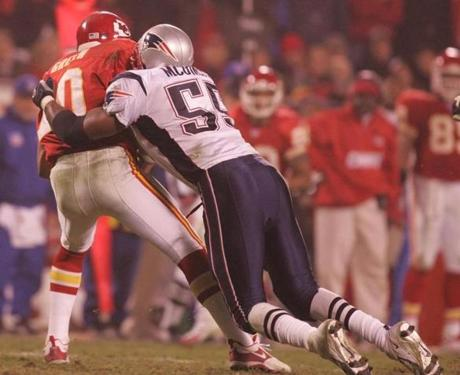 Willie McGinest sacked Chiefs quarterback Trent Green during the fourth quarter.
