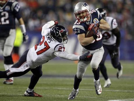 Wes Welker (R) broke away from Houston Texans safety Quintin Demps during the first half.