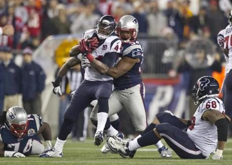 New England's Dont'a Hightower stops Houston Texans running back Ben Tate during fourth quarter.