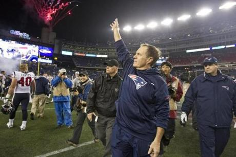 New England Patriots head coach Bill Belichick waved to fans after the 42-14 victory over the Houston Texans.