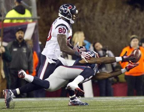 New England's Aquib Talib broke up a pass intended for Houston's Andre Johnson during second-quarter action.