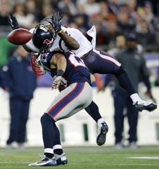 Patriots safety Steve Gregory breaks up a pass intended for Texans wide receiver Lestar Jean, top, during the second quarter.