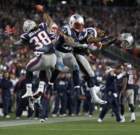 After the Patriots' Stevan Ridely scored a fourth quarter touchdown, he and fellow running backs Brandon Bolden, Danny Woodhead and Shane Vereen (right) did a celebratory jump together.