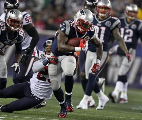 Patriots running back Stevan Ridley picks up a first quarter first down as the Texans' Glover Quin tries to bring him down.