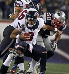 Texans quarterback Mat Schaub (8) was sacked by Patriots DL Rob Ninkovich in the first quarter.