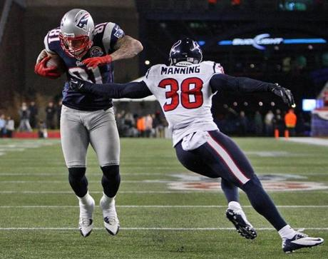 The Patriots' third touchdown came when Tom Brady hit Aaron Hernandez with a quick pass, and Hernandez sidestepped Texans defender Danieal Manning and walked into the end zone for a touchdown.