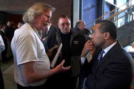 Gov. Deval Patrick listened as Plymouth commercial fisherman Ed Barrett expressed his concern over the Cape Wind project on the fishery during the Northeastern Fisheries Summit in 2010.