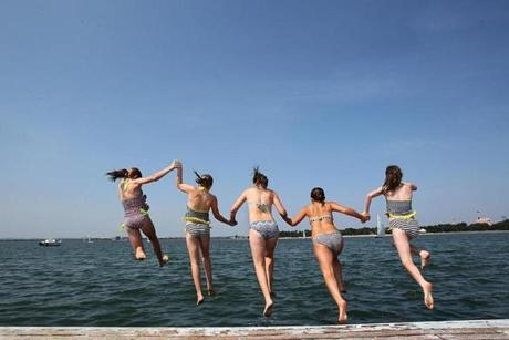 South Boston, Ma., 07/17/12, At the Harry McDonough Sailing Center, girls jump from the dock into the water at Castle Island. Left to right, Julia O'Toole, Aine O'Toole, Claire Craddock, Katie Mulvey, Aoife Devine, all cq, all from Boston. Section: Magazine. Suzanne Kreiter/Globe staff