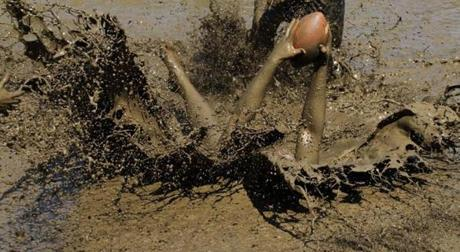 Jamie Sawler of the Muddas made an interception against the Cumberland Muckaneers. Mud football teams competed in the annual Mud Bowl, a mud football tournament in North Conway, N.H., at Hog Coliseum. Sept. 7, 2012.