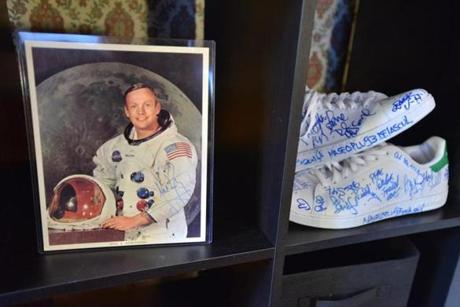 A print signed by Neil Armstrong shared a shelf with a pair of sneakers signed by hip hop artists.
