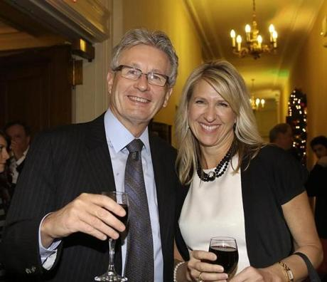 12-10-2012 Boston, Mass. Over 2,000 guests attended the 29th Annual A Company Christmas at Pops at Symphony Hall. L. to R. are Nigel Travis and his wife Joanna of Wellesley, he is CEO of Dunkin Donuts. Globe photo by Bill Brett