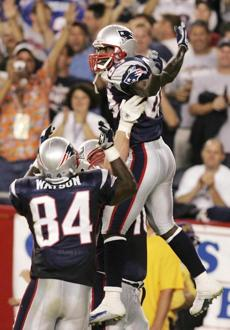 Deion Branch, who had a game-high seven catches, celebrated his touchdown catch.