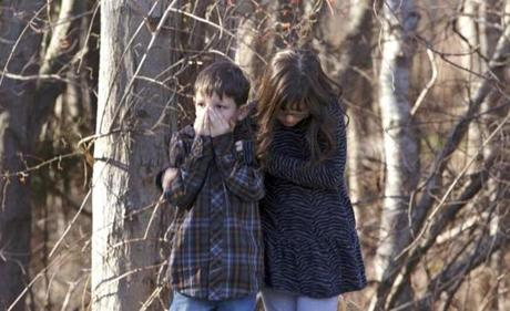 Children huddled in the aftermath of the shootings.