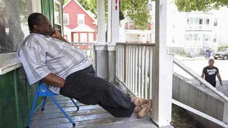Big Nate Davis has long been a fixture on his porch on Norton Street. He has lived in the house since 1970, when he was 10 and he and his mother moved from Baltimore to Boston.