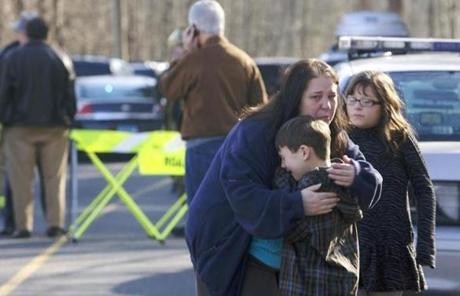 A young boy was comforted outside the Sandy Hook Elementary School in Newtown, Conn., after a shooting at the school Friday.