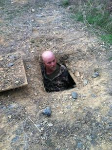 "Doug in his spider hole in the National Geographic series, ""Doomsday Preppers."""