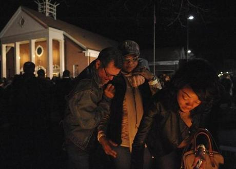 Strangers comforted each other during a memorial service at Saint Rose of Lima Catholic Church in Newtown, Conn.