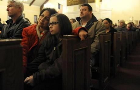 NEWTOWN, CT - DECEMBER 14: Mourners gather inside the St. Rose of Lima Roman Catholic Church at a vigil service for victims of the Sandy Hook School shooting December 14, 2012 in Newtown, Connecticut. Twenty-seven people are dead, including 20 children, after a gunman identified as Adam Lanza in news reports opened fire in the school. Lanza also reportedly died at the scene. (Photo by Andrew Gombert-Pool/Getty Images)