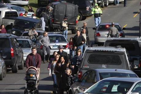 Parents walked away from the Sandy Hook Elementary School with their children.