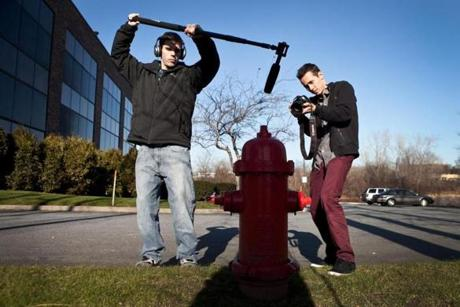 Justin Parker (left) and Jimmy Craig filming in Danvers.
