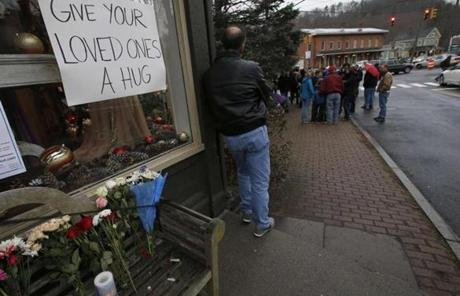 A man stood near a makeshift memorial near the Sandy Hook Elementary School.