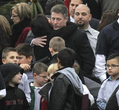People outside of Honan Funeral Home in Newtown, Conn., during the service for Jack Pinto, 6, who was killed in the school massacre on Dec. 14.