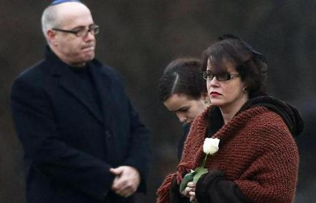 Veronique Pozner (right), mother of shooting victim Noah Pozner, walked to his gravesite for his burial in Monroe, Conn.
