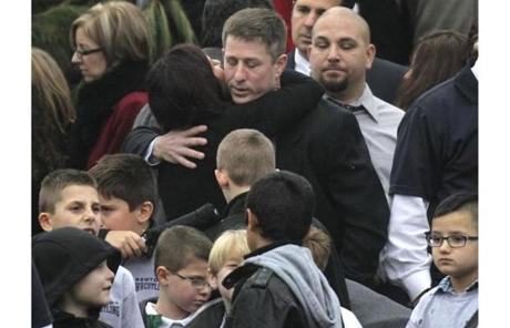 Mourners hugged outside of Pinto's funeral.