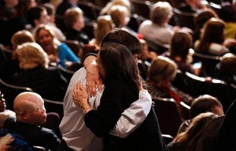 Attendees at a memorial service Sunday evening in Newtown waited for the event to begin.