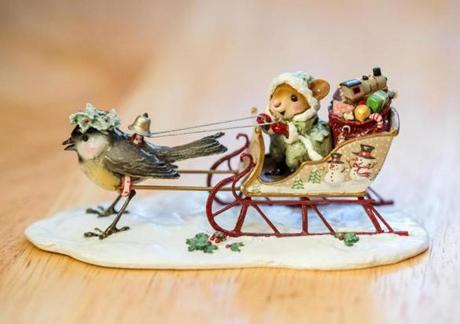 A mouse on a sleigh.