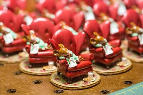 A collection of small mice slept in red chairs while waiting for Santa.