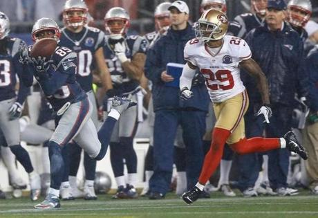 Brandon Lloyd hauled in this pass in front of Chris Culliver in the fourth quarter.