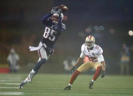 Brandon Lloyd was unable to catch this pass under the pressure of Carlos Rogers in the first half.