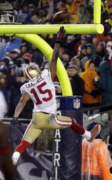 49ers receiver Michael Crabtree spiked the ball over the goal post after scoring in the third quarter.