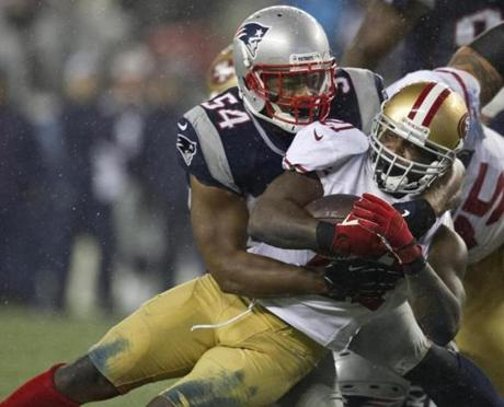 Dont'a Hightower stopped 49ers running back Frank Gore for a short gain during third quarter.