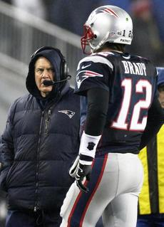 Bill Belichick watched Brady come off the field after a turnover.