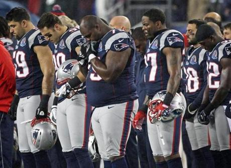 The Patriots paused for a moment of silence to remember victims of the Newtown, Conn., shooting.
