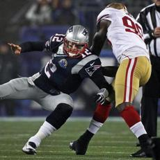 Brady was tossed to the ground by 49ers linebacker Aldon Smith.